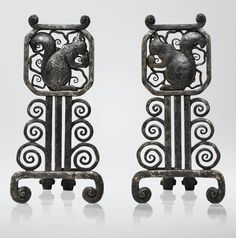 EDGAR BRANDT 1880 - 1960 PAIRE DE CHENETS, VERS 1920 A PAIR OF WROUGHT-IRON ANDIRONS BY EDGAR BRANDT, CIRCA 1920. EACH STAMPED
