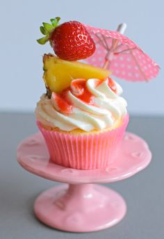 PINEAPPLE-Coconut-Rum-Cupcakes with a Strawberry Filling and Coconut-Mascarpone Frosting https://thecupcakedailyblog.com/pineapple-coconut-rum-cupcakes/ #cupcakes #recipes #baking http://1foodforhealth.blogspot.com/