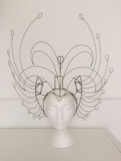 Statement wire headframe for samba or show costume With 3 panels for feather attachment. Measurement from centre point of face to top is 45cm Width