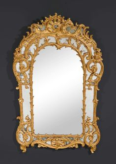 "c1760 MIRROR ""AUX CARTOUCHES"", Louis XV, Paris circa 1760. Pierced and richly carved giltwood. H 170 cm. W 106 cm. Sold for CHF 16 000 (hammer price)"