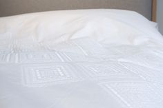 The 'Diamond' white cotton embroidered bedding collection has a diamond pattern in white thread over a soft white cotton. Stylish and cosy white bedding. King Size Duvet Covers, Double Duvet Covers, Bed Company, Embroidered Bedding, White Bedrooms, White Bedding, Bedding Collections, Diamond Pattern, White Cotton