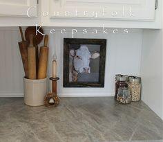 White farmhouse kitchen  beadboard backsplash, Formica Soapstone Sequoia laminate countertop and a cow print. <3
