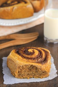 Pumpkin Cinnamon Rolls -- a lightened up version with almost NONE of the fat! The perfect breakfast treat & they don't taste healthy at all!