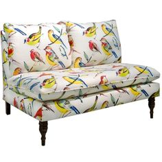 Brighten up your living room decor with this unique Skyline armless loveseat. Vibrant 'Birdwatcher Summer' upholstery covers the cozy padding of the seat and cushion. Completed with classic espresso t