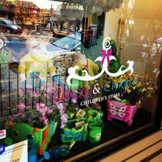 Coco & Charlie Children's Store. Spring window display. Retail window ...