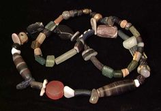 AN INDUS VALLEY/BACTRIAN BEAD NECKLACE, c. 2nd-1st millennium BC. Various stone and glass beads.    EDGAR L. OWEN, Ltd. ®    Source: A Premier Gallery of Antiquities, Ancient Coins and World Art:    http://edgarlowen.com/index.shtml