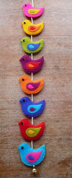 Bird felt mobile is very colourful. Easy to make in colours of your choice. Can be adapted for Christmas. Embroider the eyes.