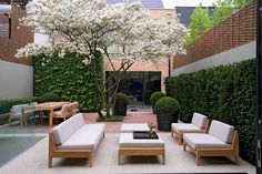 Arranged around a snowy mespilus in full flower, custom-made furniture by Giubbilei & de Leval turns a London terrace into an elegant living area.