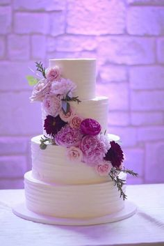 Buttercream wedding cake with peonies dahlias, and rannunculus
