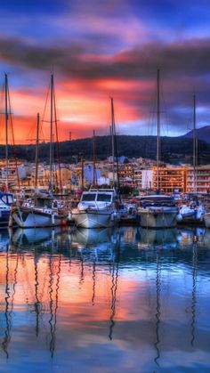 Greece - Crete. The colors from the sun are beautiful in this view of the boats and shore