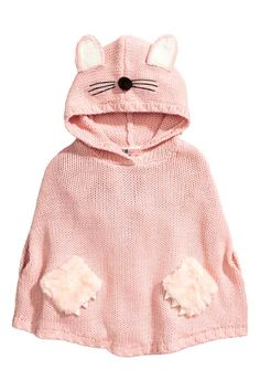 Knitted poncho: Poncho in a soft knit with an embroidered hood with appliqués, holes in the side seams for the hands and faux fur patch pockets on the front. Unlined.