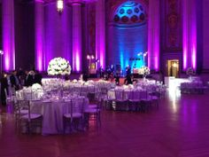 Purple, white and silver wedding reception. Purple and blue lighting. White pinspots. White tall centerpieces. Design by HJ Planners. Florals by Edge Flowers. Lighting by Digital Lightning.