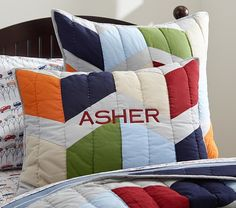 Make shams for boys' room: Landon Quilted Bedding | Pottery Barn Kids I like this oversized flying geese (chevron) pattern with lighter colors used for background to lighten bed colors up.