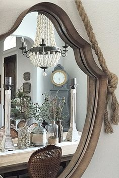 Add a statement mirror to your wall to make a small space bigger! Via our Instagram.