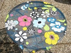Outdoor table clothe out of a shower curtain. Great idea, not this design, but it is creative.