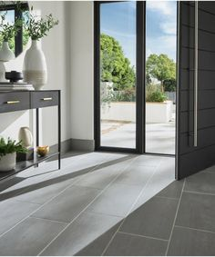Inara™ Tiles | Topps Tiles Concrete Bathroom, Concrete Tiles, Cement, Insulated Garden Room, Indoor Range, Topps Tiles, Multi Fuel Stove, Outdoor Tiles, Adhesive Tiles