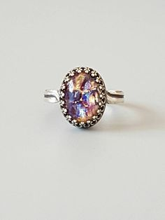 Check out this item in my Etsy shop https://www.etsy.com/uk/listing/252104866/adjustable-amethyst-ring-antique-silver