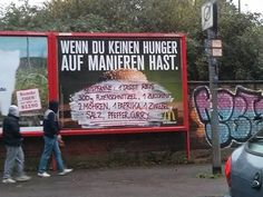 In Cologne, Germany, a street artist/activist (or, if you're on the side of big corporations, a vandal) has been whiting out parts of fast food billboards and writing recipes for actual food on top.
