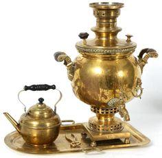 Russian Brass Tea Set w/ Samovar. Set includes a gilt brass tray, teapot, tongs and a large samovar (kettle); circa 1890's.