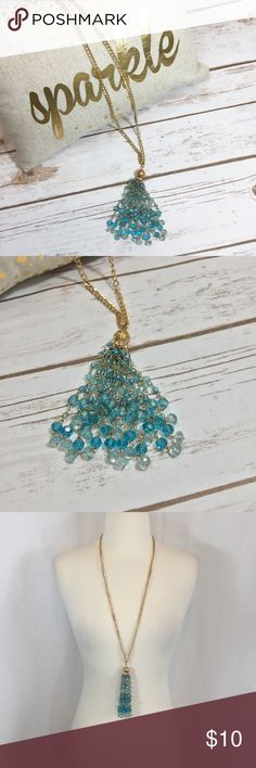 Gorgeous turquoise and gold tassel necklace Gorgeous turquoise bead and gold chain tassel necklace from charming Charlie 32 inch chain with a 3 inch extender 5 inch drop on the tassel Charming Charlie Jewelry Necklaces