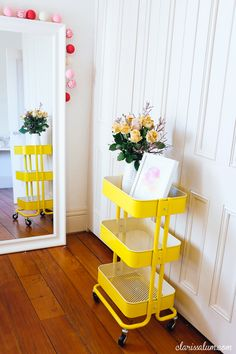 Painted a cheery yellow, the cart brightens a living room corner — and is just waiting to stash your remote control, too. See more at Clarissa Lum » - HouseBeautiful.com
