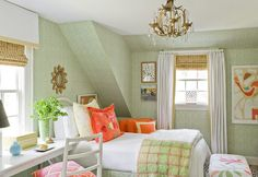 green hatched wallpaper orange accents attic bedroom