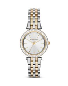 55f554b4c22 A gorgeous rim of stones illuminates a sleek three-hand dial on Michael  Kors