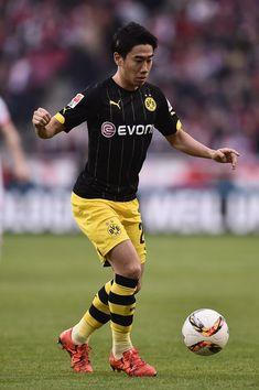 Shinji Kagawa of Borussia Dortmund controls the ball during the Bundesliga match…