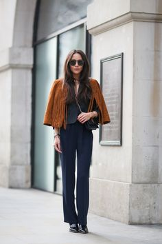 If you want to play with the fringe trend but fear its intensity, go for a shrunken jacket worn on the shoulders with an otherwise all-black look