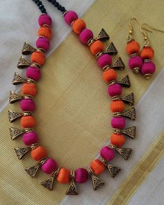 Multi color Silk Thread Long Necklace Set Orange and magenta colour beads with Antique bails 1 set Earings Silk Thread Earrings Designs, Silk Thread Necklace, Beaded Necklace Patterns, Silk Thread Bangles, Thread Jewellery, Fabric Jewelry, Jewelry Patterns, Beaded Jewelry, Jewellery Making