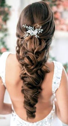Bride's long loose braid bridal hair ideas Toni Kami Wedding Hairstyles ♥ ❷ threadsandlaces.co.uk
