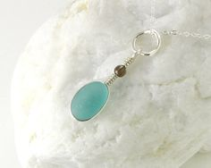 Aqua Beach Sea Glass Necklace - Ocean Blue English Seaglass Pendant with Wire Wrapped Bezel and Organic Ring - Sterling Silver. $79.00, via Etsy.