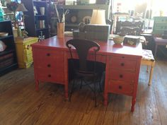 Desk distressed in layers of American Paint Company Home Turf, Beach Glass, Orange Grove and topped with Fireworks Red.