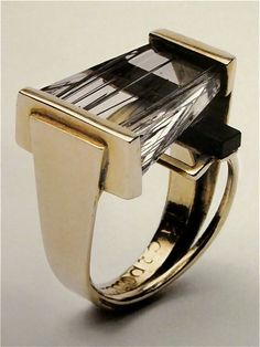 Ring by Margaret De Patta, 1954   (Ms. De Patta was a founding member of the San Francisco Metal Arts Guild and one of the few American metalworking jewelers to present ideas evolving from the modern art movement of the time)