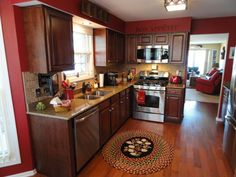 Thomasville-Kitchen-Cabinets-Decoration-Colors-with-Red-Color-Theme-Brown-Wooden-Detail-Design-Medium-Wood-Cherry-Design-Backsplash-Combined-Lighting-Natural-Hardwood - Top Inspirations
