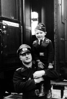 Father and son wearing the Black Panzer Uniform. His son wears the popular black version of the officer's field cap. The Black, two-piece Panzer Uniform were worn by armored troops and personnel.