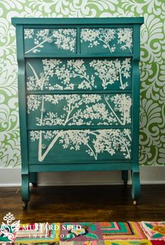 Idea for my dressers. The drawers are stained a dark espresso color. I am thinking of painting the dresser white, leaving the drawers stained dark espresso and then putting a white design like this on the drawers. Thoughts?