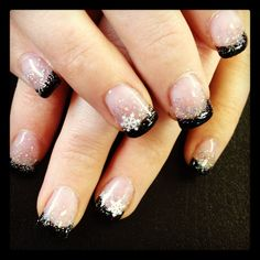 Very subtle and classy holiday nails. Snow flakes dress this look up so it can be worn with for a night or out a Christmas party. #christmasnails #nailart