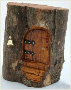 Fairy House - Love the use of one of those many logs and stumps around the place. The doors are made from reclaimed timber. The houses are quite magical - hobbits or fairies come to mind, could add little details - add to the imagination.: