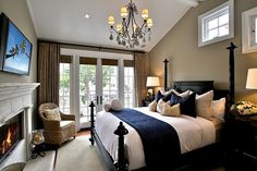 White and navy bedding with brown walls.