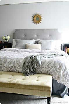For less than $100, you can create a beautiful tufted headboard that is soft and shaped however you want. You will need to choose your shape first and then make sure that you have fabric and some foam on hand to create the headboard. You'll cut the shape out of plywood and then cover that with foam (like from an eggshell mattress cover) and then cover again with fabric. The embellishments are completely up to you and the best part is that even without any of the supplies, this one will cost…