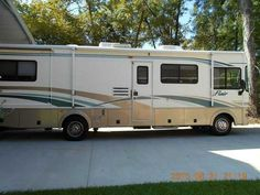 2003 Used Fleetwood Flair 31 Class A in Florida FL.Recreational Vehicle, rv, 2003 Fleetwood Flair 31, Loaded with extra's and options for this model year. non-smokers- no pets Exterior features: 35 cu ft basement storage-aluminum storage doors, lighted and carpeted. spare tire storage area.Power entry 2 steps, 3 colorway graphics, Slider Windows throughout. Fiberglas front cap, 30-amp service, Steel floor-wall-ceiling framing, 5.5 kw Onan generator, TPO roof, Roof ladder, entry door…