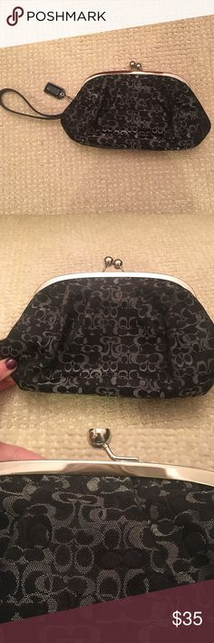 """Coach black and grey Wristlet This a is Coach Wristlet measuring 9""""x4.5"""". It's black and grey with a little shimmer. Coach Bags Clutches & Wristlets"""