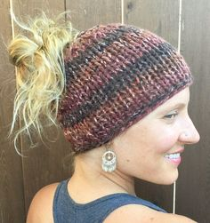 Free Knitting Pattern for Chunky Knit Messy Bun Hat - Easy hat knit flat and seamed to leave a top opening for messy bun or ponytail. Designed by Marni Reecer. Quick knit in super bulky yarn.