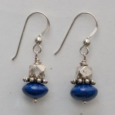 """Smooth lapis roundels topped with granulated and faceted India sterling silver beads, sterling silver ear wires, 1 1/4"""" long"""