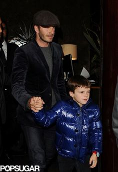 Cruz held on to dad David Beckham Friday night in London. | More cute pictures here!