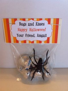 "Halloween Treat Bag filled with kisses and a plastic spider. ""Bugs and kisses happy halloween your friend ____"" this would be cute for a classroom treat"
