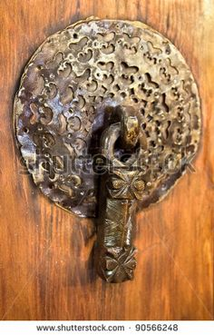 Male bronze antique drawer door handle, Esfahan, Isfahan. Iran by Aleksandar Todorovic, via Shutterstock
