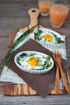 Shirred or baked eggs are one of my favorite meals. These are baked in a bed of fresh arugula and topped with parmesan and fresh chives.