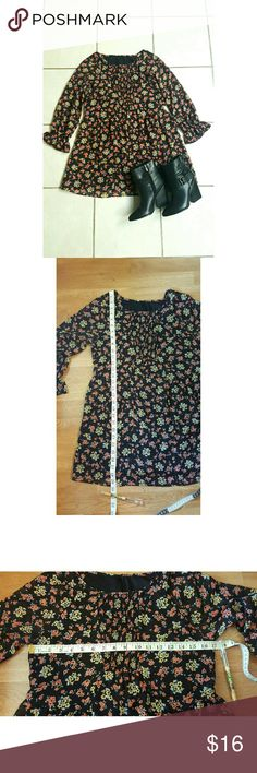Free people court me with flowers tunic Floral baby doll tunic with stretchy smocking on front of chest. The sleeve hems are stretchy with ruffle detail. Light pleating below waistline, hidden zipper on back. Sheer sleeves, and rest of dress is a little sheer but has lining. Not sure of the size, has no tag but I think it might be a small. Please see measurements... comes from a smoke free home. Free People Dresses Mini